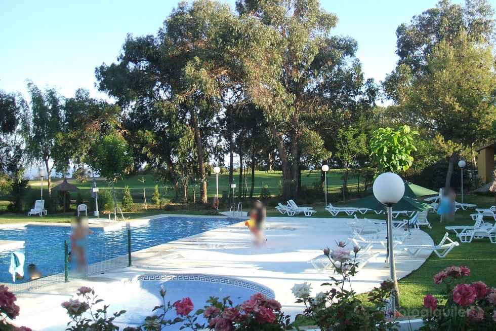 Chalet con piscina y campo de golf en Islantilla, un dormitorio.